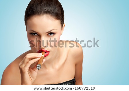 A creative portrait of a beautiful sexy rich woman smoking cigar. - stock photo