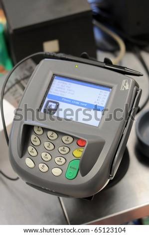 A credit card machine in a store. - stock photo