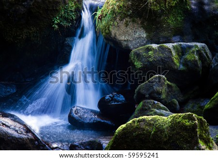 A creek with running water and stone (rock) - stock photo