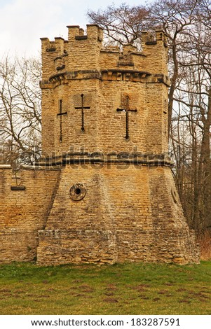 A crenelated tower set at the corner of a wall - stock photo