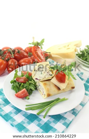 a crepe stuffed with cheese, radishes and chives - stock photo