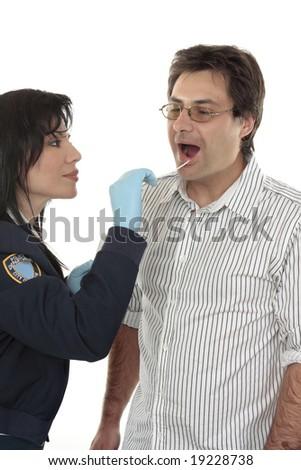A crime scene investigator obtains a dna sample from a suspect criminal. - stock photo