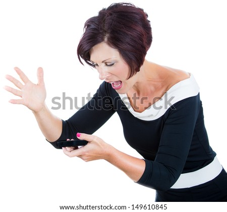 A cropped close-up portrait of a screaming angry woman, wife, executive on the mobile phone. Dynamic and energetic image of young caucasian woman in black dress isolated on white background. - stock photo