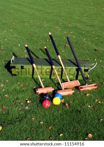 A Croquet set on the lawn - stock photo