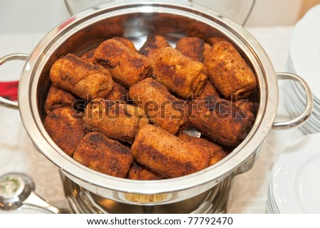 A croquette is a small fried food roll containing usually as main ingredients mashed potatoes, and/or minced meat