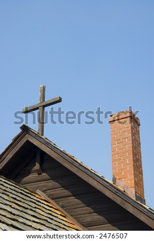 A cross and a chimney atop a church in Grand Teton National Park