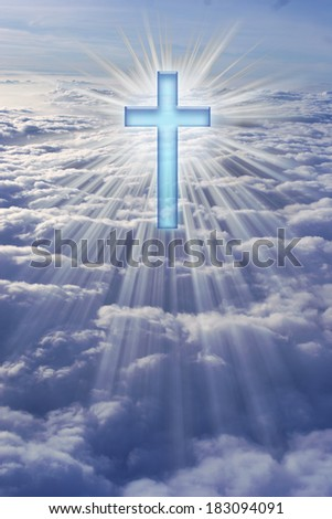 A cross in heaven surrounded by rays of light. - stock photo