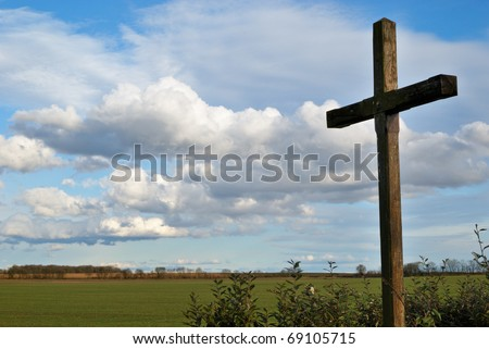 A cross in the country under a low sky
