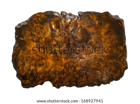 A cross section of a wood burl showing the many swirls and knots embedded in the wood matrix. - stock photo