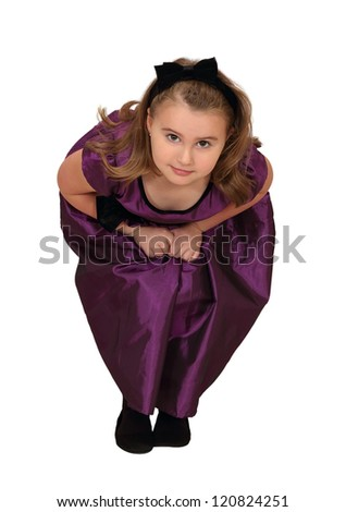 A crouching girl sneaks up on you with mischief in mind isolated on white - stock photo