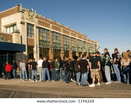 A crowd of kids waits for the doors to open for a concert at Convention Hall in Asbury Park NJ. - stock photo