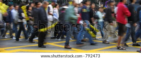A crowd of people walking on the street