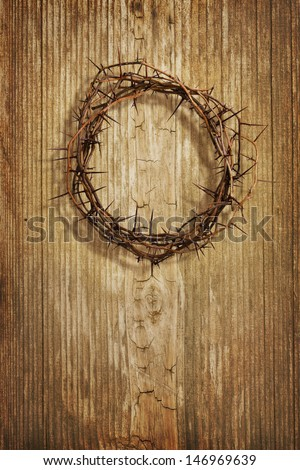 A crown of thorns on grunge wood background - stock photo