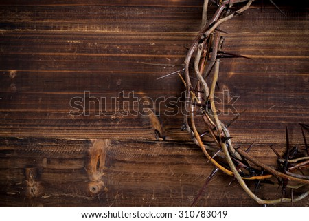 A crown on thorns, a religious symbol on a wooden background - Easter background - stock photo