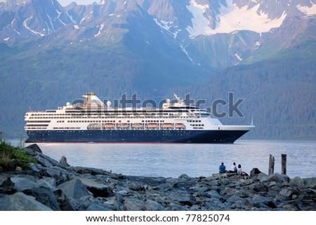 A Cruise Ship Leaving Seward Harbor at Sunset - stock photo