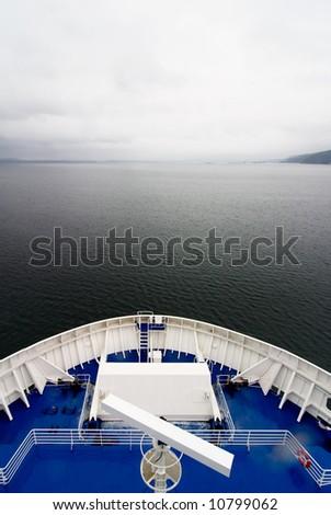 A cruise ship on the open ocean - stock photo