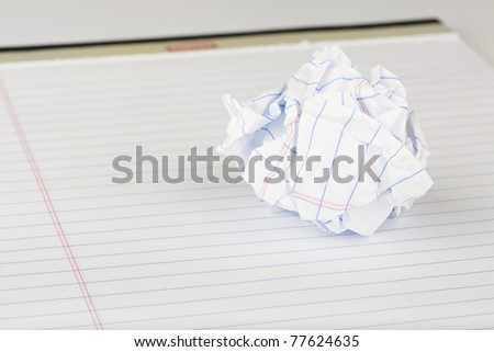 A crumpled up piece of notebook paper - stock photo