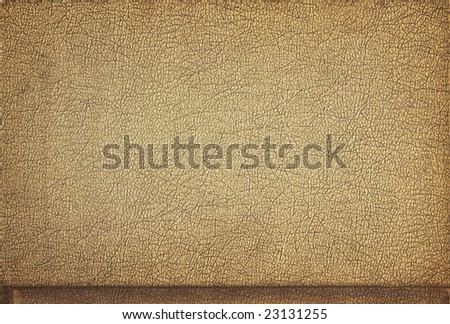 A crusty tan piece of leather, suitable for a background texture. - stock photo