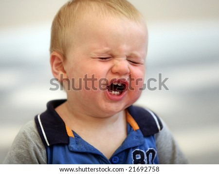 A crying one year old baby boy - stock photo