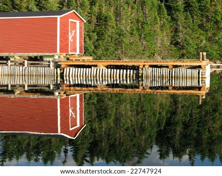 A crystal clear reflection of a fishing wharf.