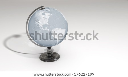 A crystal globe on a chrome pedestal over white featuring the western hemisphere. Some elements of this image furnished by NASA.