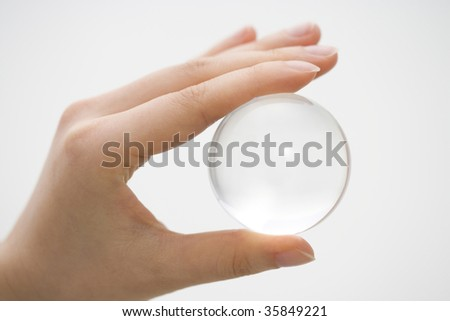 A crystal holding with a woman's hand - stock photo