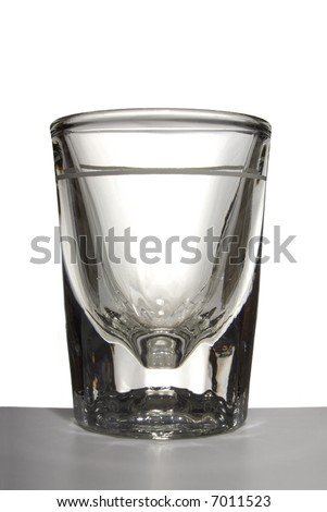 A crystal shot glass isolated on white - stock photo