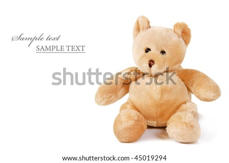 a Cuddly teddy bear on a white background with space for text - stock photo