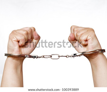 A cuffed hands clenched fists on the white background