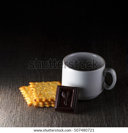 a cup. chocolate. biscuit