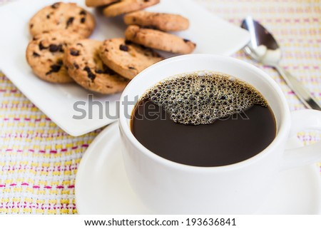 A cup of black coffe with cookies butter - stock photo