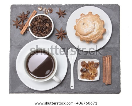 A cup of black coffee espresso with cupcake, on the black stone plate, top view. Morning breakfast. Coffee break on the work.  - stock photo