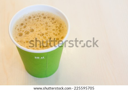 A cup of black coffee in the paper glass - stock photo