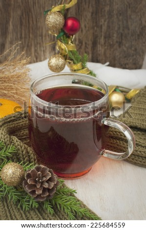 a cup of black tea and Christmas decoration
