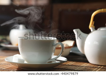 a cup of black tea and steam