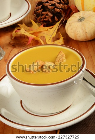 A cup of butternut squash with cornbread pumpkin croutons