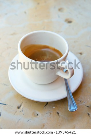 A cup of caffee on the table in a bar - stock photo