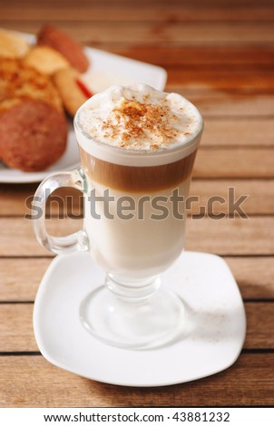 A cup of cappuccino coffee - stock photo