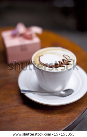 a cup of cappuccino on the table