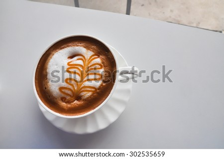 A Cup of Cappuccino with Froth, A Cup of Cappuccino with Froth in coffee shop