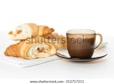 A cup of coffee and  cornettos on white background - stock photo