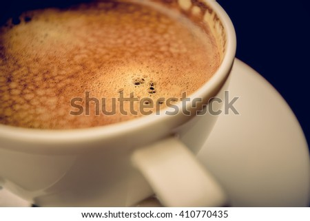 A cup of coffee bubble with froth on white background - stock photo