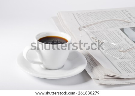 A cup of coffee, glasses and newspaper on white background. - stock photo
