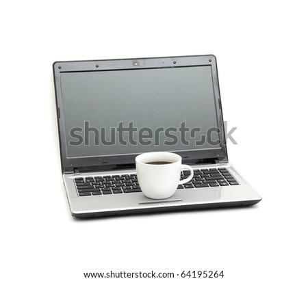A cup of coffee on a laptop - stock photo
