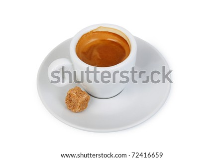 a cup of coffee on a saucer and a piece of cane sugar