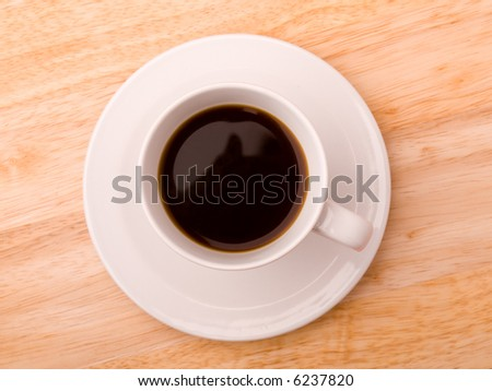 A cup of coffee on a wood background