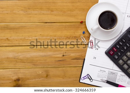 A cup of coffee on an office desk. - stock photo