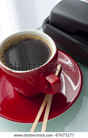 A Cup of coffee on the desk - stock photo