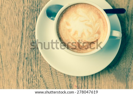 A cup of coffee  on wooden - stock photo