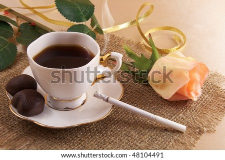 A cup of coffee, rose and cigarette - stock photo
